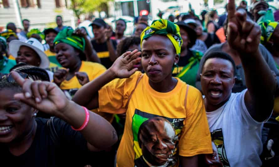 African National Congress supporters celebrate outside parliament in Cape Town