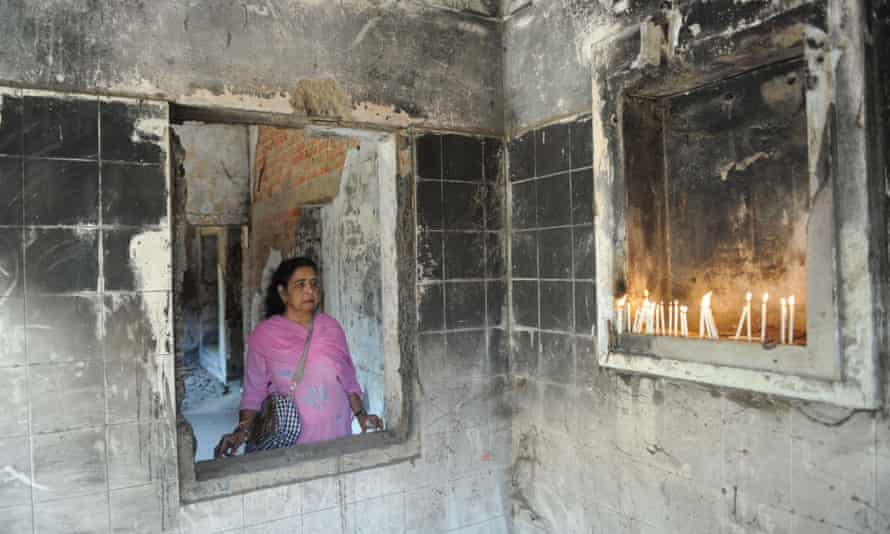 A woman pays homage to those killed at the Gulbarg Society in Ahmedabad in 2002