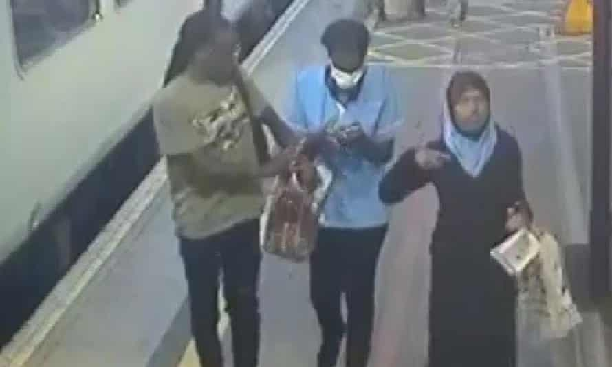 Fatuma pictured alongside an unknown man and woman.