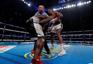 The referee steps in to stop the fight.