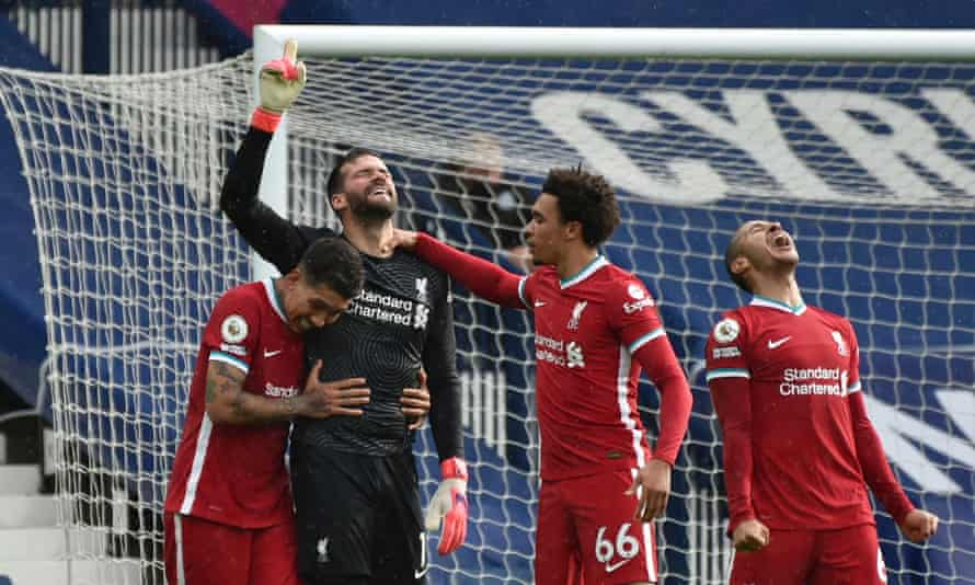 Alisson points to the sky in delight after the goalkeeper's astonishing winner for Liverpool