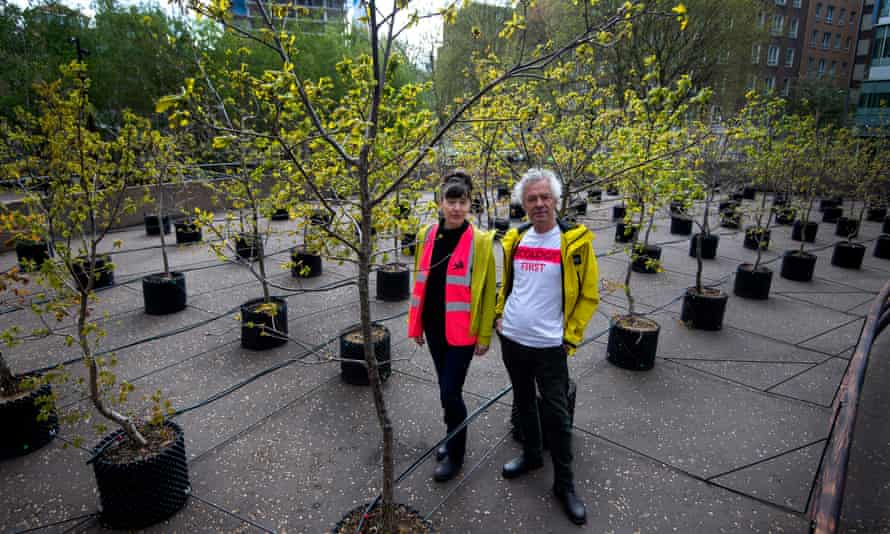 Artists Heather Ackroyd and Dan Harvey with their 100 oak saplings outside the Tate Modern.