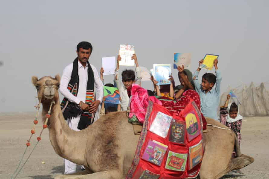 Teacher Ismail Yaqoob (left) with children in Gwadar district