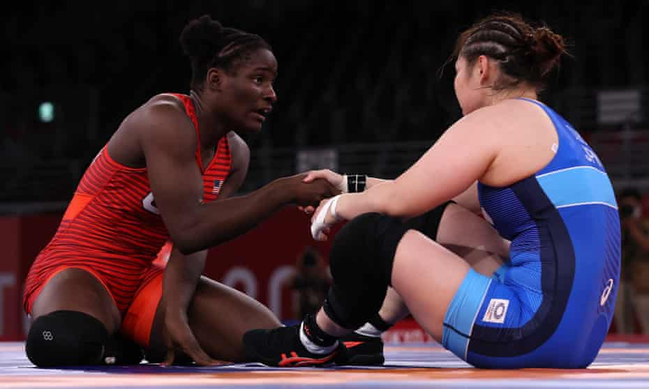 Tamyra Mensah-Stock commiserates with Sara Dosho of Team Japan after her victory during the women's 68kg wrestling