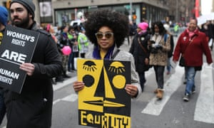 A woman attends the Women's March in New York in 2018.
