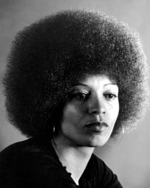 Davis in 1974, with her signature look.
