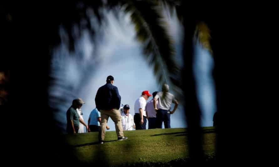 U.S. President Donald Trump plays golf at the Trump International Golf Club in West Palm Beach, Florida, before signing the Covid relief bill