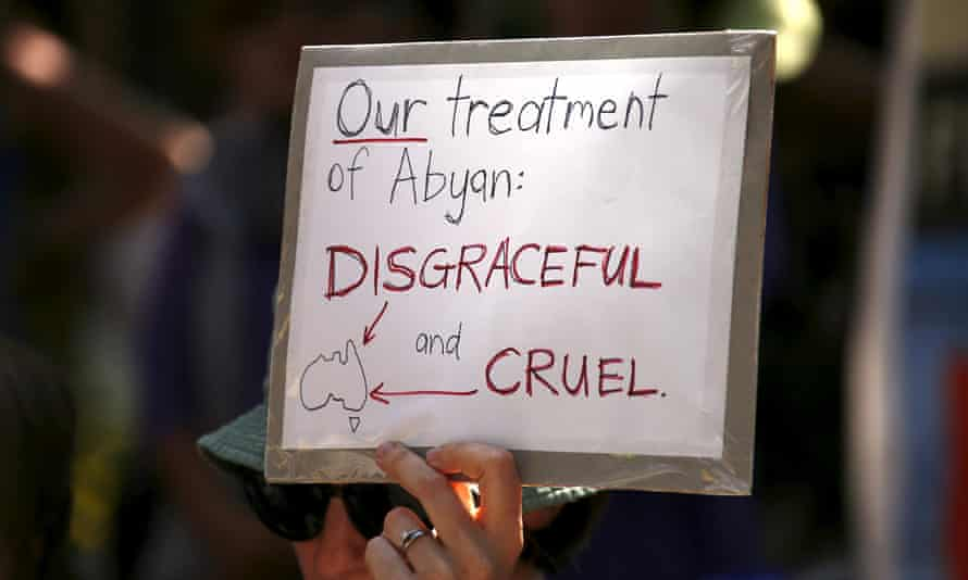 A protester supports refugees during a rally in Sydney.
