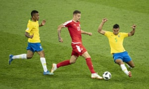 Sergej Milinkovic-Savic tries to avoid Casemiro's tackle against Brazil.