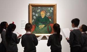 Schoolchildren examine the painting La Berceuse, by Van Gogh.