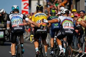 <strong>Stage Six</strong><br>Stage Location: Abbeville to Le Havre, France<br>Stage winner: Zdenek Stybar<br>Tony Martin is helped over the line by his Etixx-Quick Step team mates. Martin later announced that he was forced to retire after sustaining a broken collar bone after being involved in the earlier crash