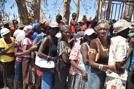 Haitians in Roche-a-Bateaux, Les Cayes, wait to receive food from the UN's World Food Programme