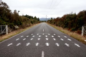 Greymouth, New Zealand: White crosses are painted on the access road to the Pike River mine
