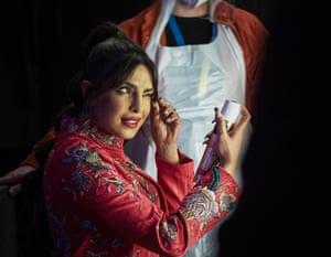 Priyanka Chopra Jonas tidies an eyebrow backstage.