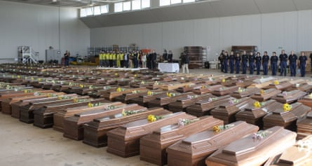 Rows of coffins fill an airport hangar in the Italian island of Lampedusa after a migrant boat sank in October 2013.