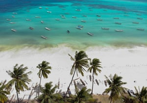 Small wooden fishing boats are pictured by a drone off the coast of Zanzibar
