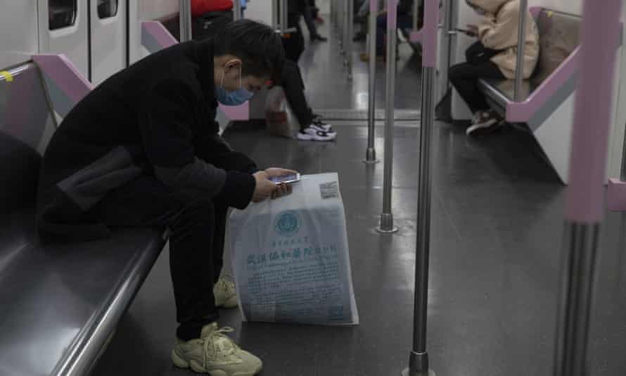 A passenger takes the subway in Wuhan in central China's Hubei province.