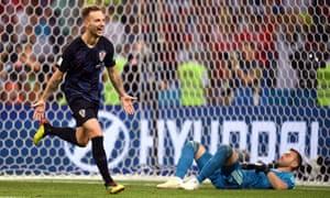 Ivan Rakitic celebrates after scoring the winning penalty.