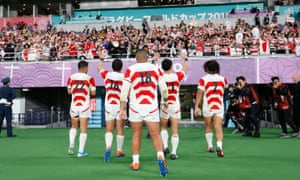 Japan players wave to the crowd
