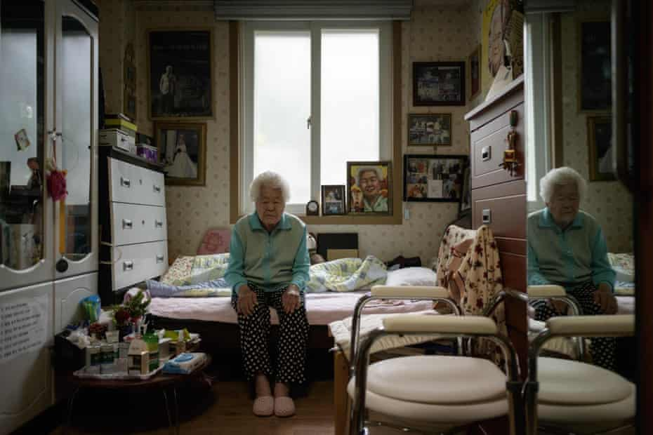 Former comfort woman Lee Ok-sun sits in her bedroom at the 'Sharing House', a commune and nursing home for former comfort women, in Toechon village, east of Seoul on April 8, 2018.