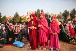 Three girls in red