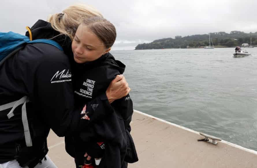Thunberg gets a hug before she begins her voyage.
