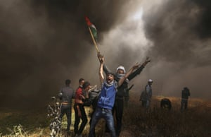 Palestinian demonstrators shout during clashes with Israeli troops at a protest demanding the right to return to their homeland at the border between Israel and Gaza.