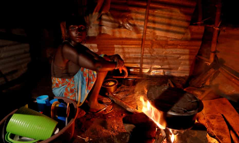 Maria Jofresse, 25, cooking in her makeshift shelter outside the village of Cheia, near Beira, Mozambique, lost her two children during Cyclone Idai, but can't find their graves anymore.