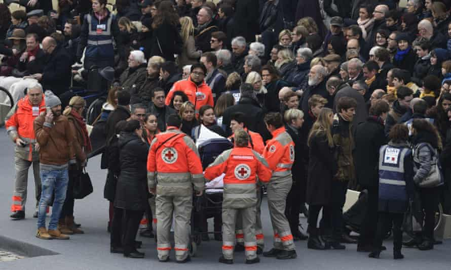 Members of the French Red Cross accompany people wounded in the Paris terror attacks.