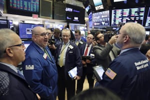 Specialist Peter Giacchi, left, calls out prices during Spotify IPO on the floor of the New York Stock Exchange today.