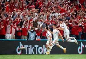 Denmark's Joakim Maehle celebrates scoring their fourth goal.