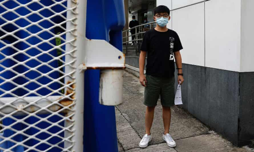 Joshua Wong leaves a police station after being arrested.