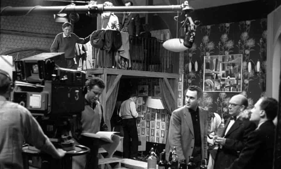 From left: Philip Saville looking at the script, Harold Pinter, Arthur Lowe and Stanley Meadows on the set of Armchair Theatre - A Night Out, in 1960.