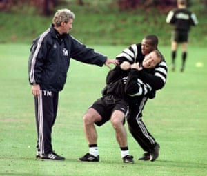 Newcastle coach Terry McDermott tries to put an end to some training ground high-jinks between Asprilla and Alan Shearer in November 1996.