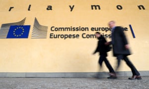 People walk past the European commission headquarters in Brussels.