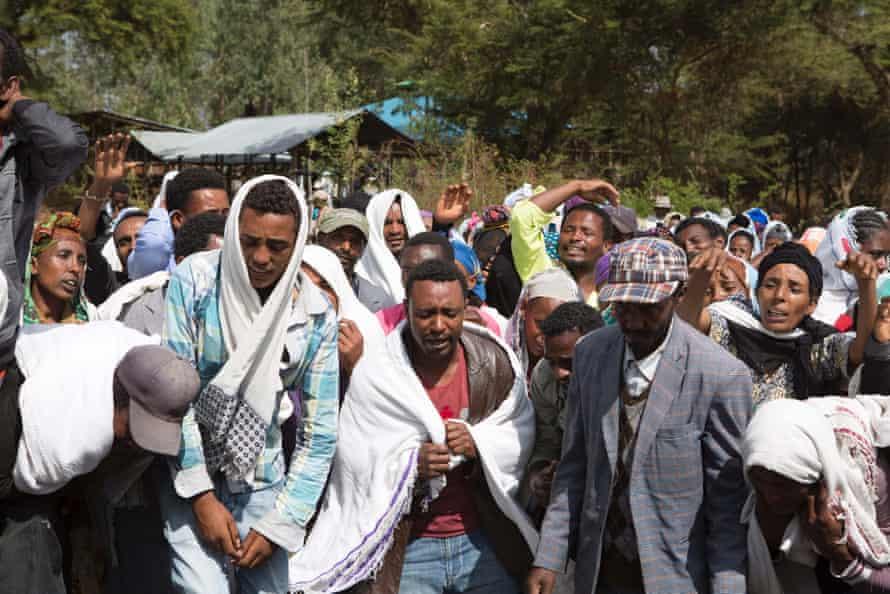 People in Yubdo village, in Ethiopia's Oromia region, mourn the death of Dinka Chala in December 2015