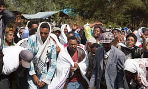 People mourn the death of a protester who was shot by Ethiopian forces in the Oromia region, 17 December.