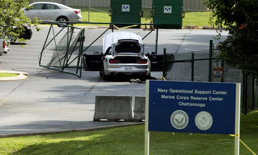 A car tangled in fencing sits parked just inside the gate at a military base in Chattanooga where a gunman killed four US marines.