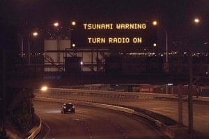 A tsunami warning alert is seen on a noticeboard above State Highway 1 in Wellington following an earthquake centred some 59 miles (95km) north of Christchurch