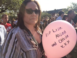 Christine Beaty holds a pink balloon - similar to those distributed at the Ariana Grande concert - at a vigil for the victims of the terror attack that happened there.
