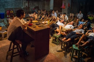 People relax during a storytelling session in a the tea house in Sichuan Province, China