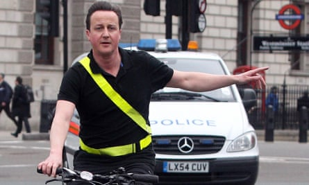 David Cameron arrives by bicycle at the House of Commons for the prime minister's questions
