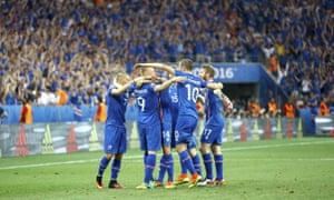 Iceland celebrate Gylfi Sigurdson's (10) equalising goal against England. Iceland went on to win 2-1.