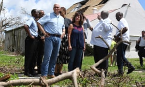 Vice President Mike Pence and his wife Karen Pence view storm damage in Christiansted, St Croix.