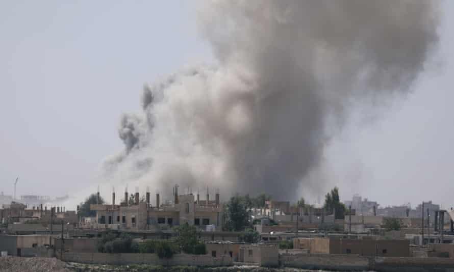 Smoke rises from the al-Mishlab district in Raqqa