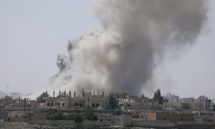 Smoke rises from the al-Mishlab district in Raqqa