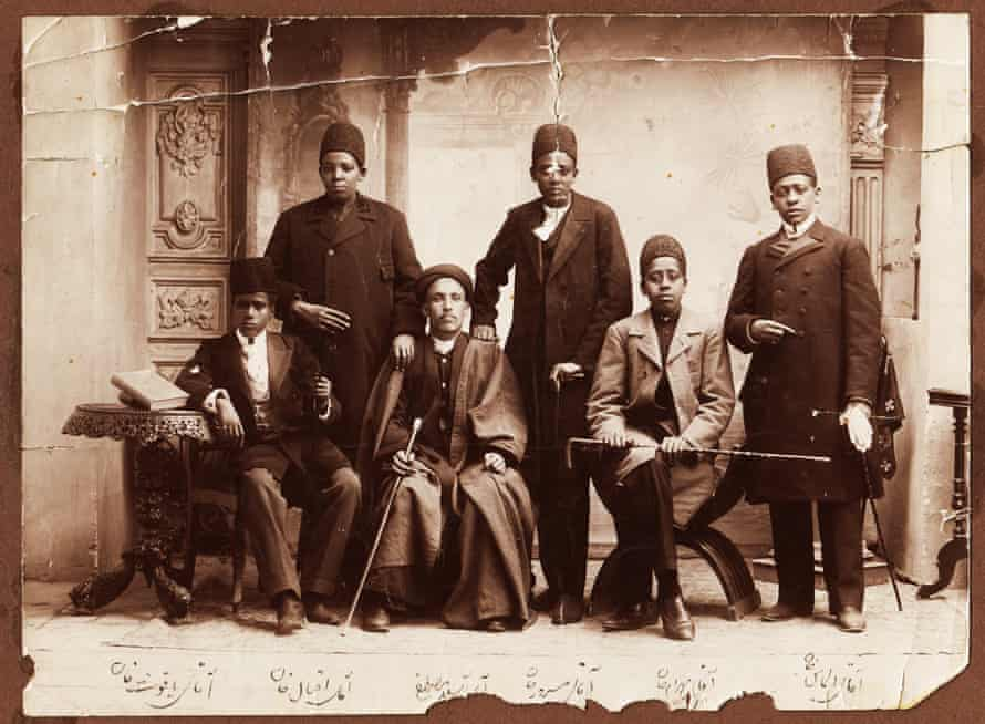 African slaves in Iran during the Qajar era were often eunuchs. Their dress suggests that they belonged to the king or high-ranking members of his court. From right: Aqay-i 'Almas khan, Aqay-i Bahram khan, Aqay-i Masrur, Aqay-i A Seyid Mustafa, Aqay-i Iqbal khan, and Aqay-i Yaqut khan (different person from other photo), 1880s