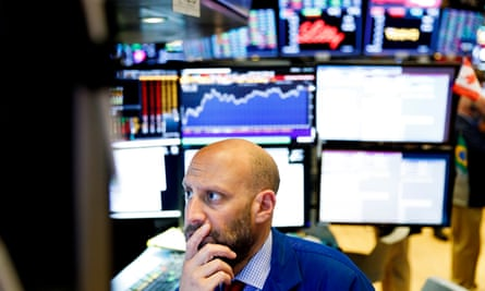 A trader works on the floor of the New York Stock Exchange in New York, New York on Tuesday.