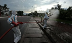 Congolese firemen begin the disinfecting operation of the state buildings and public spaces in the Gombe district of Kinshasa.