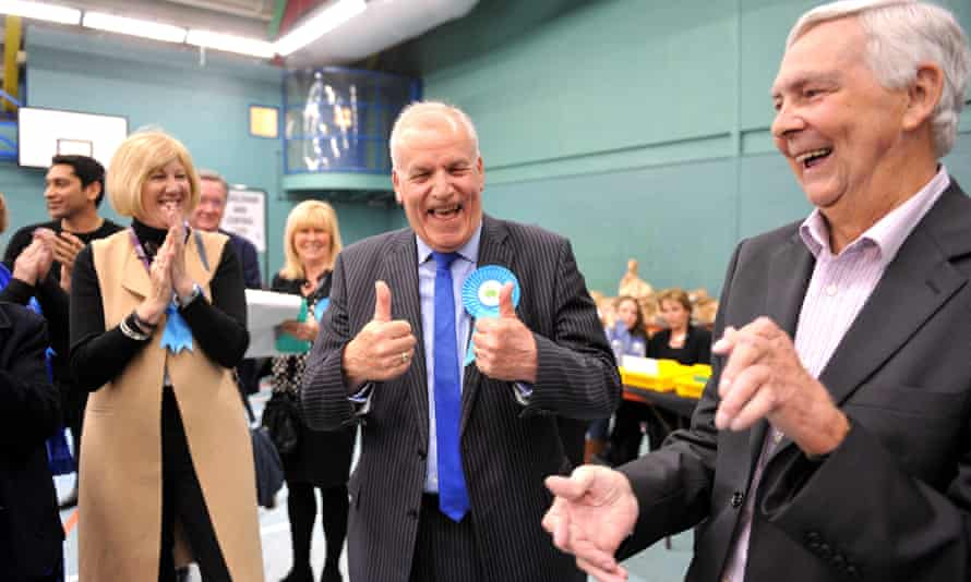 Conservative Dick Madden celebrates after retaining his seat on Essex county council.